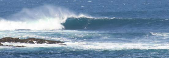 Large surf on Cowloe Reef off Sennen Cove.